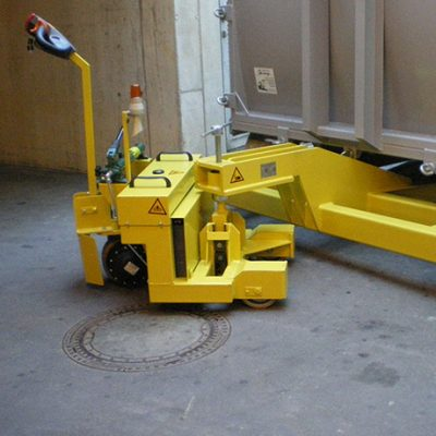 Container pallet trucks and carriages